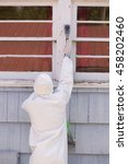a house painter in a hazmat... | Shutterstock . vector #458202460