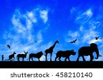 Stock photo silhouettes of animals on blue cloudy sky background 458210140