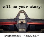 Small photo of Close up of old typewriter covered with dust with tell us your story text