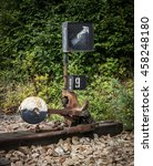 Small photo of Old rusty railroad switch with counterweight, manually (hand) operated.