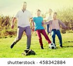 parents with two kids playing... | Shutterstock . vector #458342884