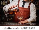 Stock photo bartender pouring fresh cocktail in fancy glass 458414590