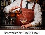 bartender pouring fresh... | Shutterstock . vector #458414590