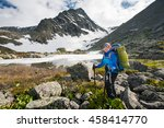hiker is posing at camera in... | Shutterstock . vector #458414770