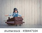 little boy with plane indoors | Shutterstock . vector #458447104