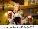 young waitress with beer mugs   Shutterstock . vector #458456590