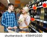 young smiling family buying... | Shutterstock . vector #458491030