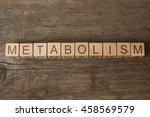 metabolism text on wooden cubes | Shutterstock . vector #458569579