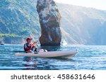 A Man Fishing On A Kayak Boat...
