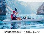 Kayaking. Man Fisherman Floats...