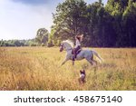 Beautiful Young Woman Riding A...