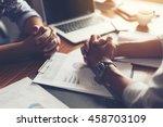 hand  two men on a desk.... | Shutterstock . vector #458703109