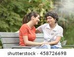Senior Woman With Carer Sittin...