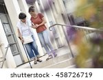 home carer helping disabled... | Shutterstock . vector #458726719