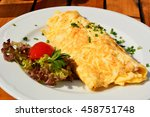 omelette with salad. | Shutterstock . vector #458751748