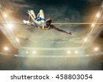 athlete in action of high jump.   Shutterstock . vector #458803054