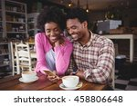 happy young couple sitting at... | Shutterstock . vector #458806648