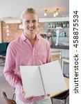 man holding a menu card in... | Shutterstock . vector #458875534