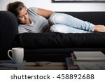 woman lying on a couch with... | Shutterstock . vector #458892688