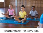school kids meditating during...