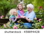happy senior lady playing with... | Shutterstock . vector #458894428