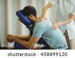 physiotherapist giving back... | Shutterstock . vector #458899120