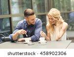 beautiful couple having coffee... | Shutterstock . vector #458902306