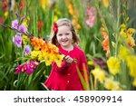 Little Girl Holding Gladiolus...