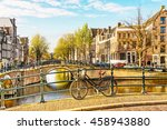 Stock photo bicycle parked on a bridge in amsterdam netherlands 458943880