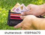 man with bills | Shutterstock . vector #458946670