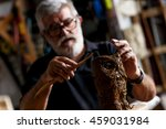 Senior Sculptor Working On His...
