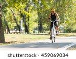 young woman riding electric... | Shutterstock . vector #459069034