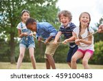 children playing tug of war at...