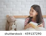 asian girl reading story book... | Shutterstock . vector #459137290