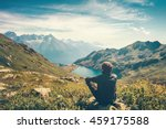 Stock photo traveler man relaxing meditation with serene view mountains and lake landscape travel lifestyle 459175588