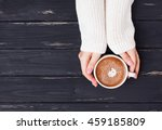 Woman's Hands Holding Cup With...