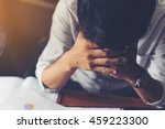 worried businessman sitting in... | Shutterstock . vector #459223300