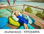 woman on a bright beanbag chair ... | Shutterstock . vector #459266896