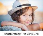 sweet girl in a hat against... | Shutterstock . vector #459341278