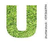 Small photo of The outline of English capital letter 'U' isolated on white background and filled in with actual photo of green grass lawn with applicable clipping or working path for design project