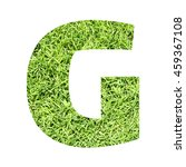 Small photo of The outline of English capital letter 'G' isolated on white background and filled in with actual photo of green grass lawn with applicable clipping or working path for design project