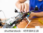 man connecting the component of ... | Shutterstock . vector #459384118