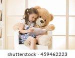 happy little girl with teddy... | Shutterstock . vector #459462223