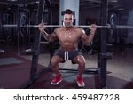 handsome man doing squats in... | Shutterstock . vector #459487228