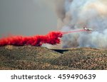 White Aircraft Dropping Fire...