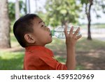lovely little boy drinking water | Shutterstock . vector #459520969