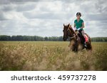 young woman riding a horse on... | Shutterstock . vector #459737278