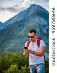 man in red backpack hiking on... | Shutterstock . vector #459780646