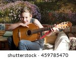 boy playing the guitar | Shutterstock . vector #459785470