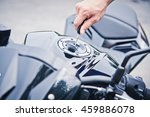 hand the key open tank cap... | Shutterstock . vector #459886078